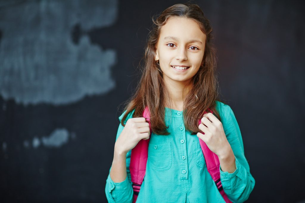Portrait of little girl smiling at camera